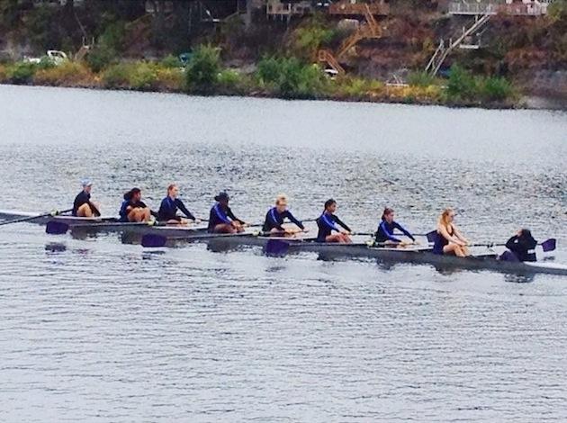 Manhattan varsity girls warm up for their big race.